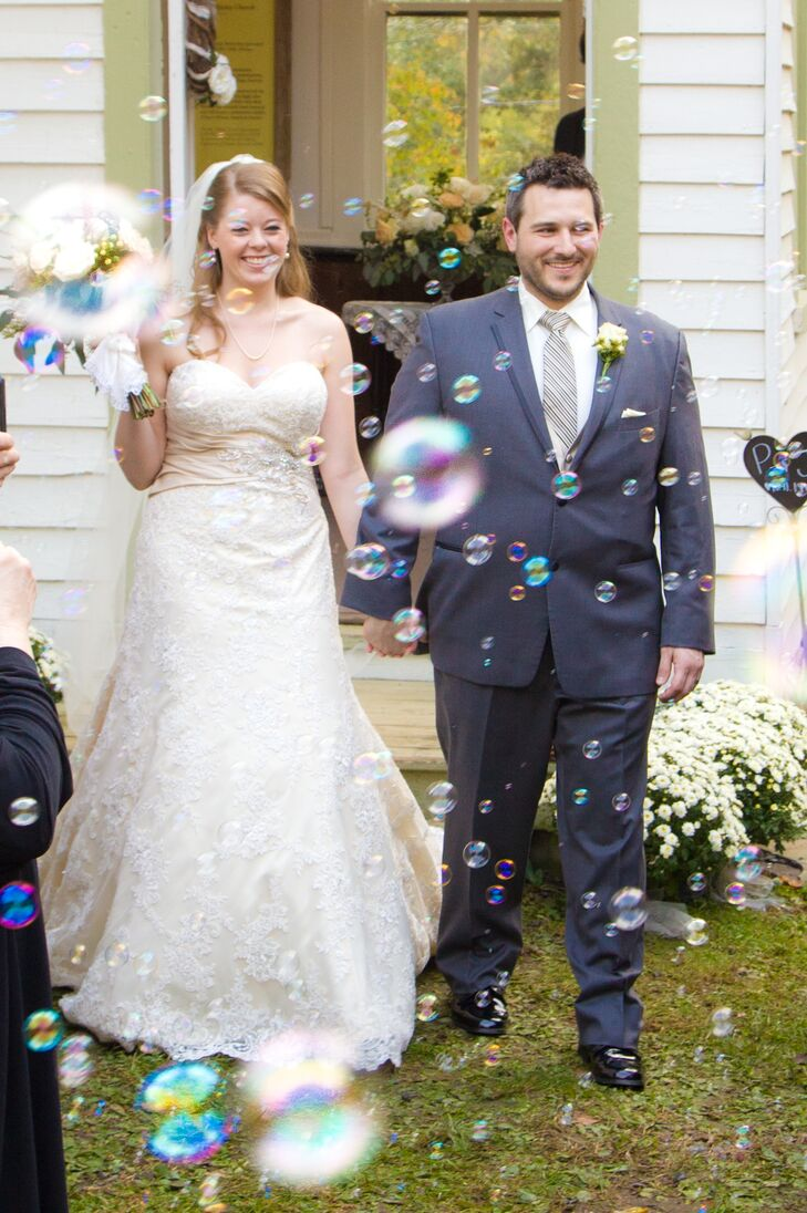 Guests blew bubbles at the newlyweds after the ceremony at John Wesley Church in Waterford, Virginia.