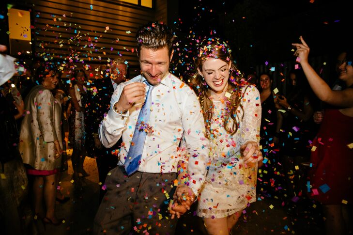 At the end of the evening, Kate and Jordan's families and friends sent them off in style by tossing bright, colorful confetti on them as they made their way to their getaway car.