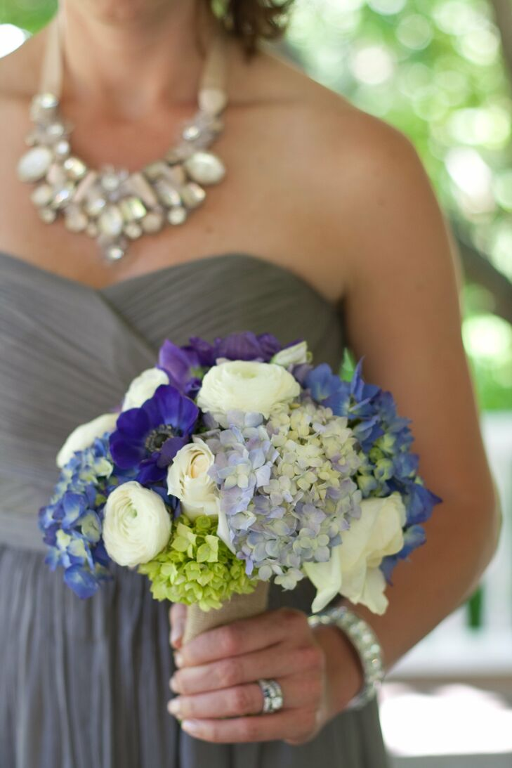 Bright purples and royal blues popped against creamy whites in Jen's bridesmaid bouquets.