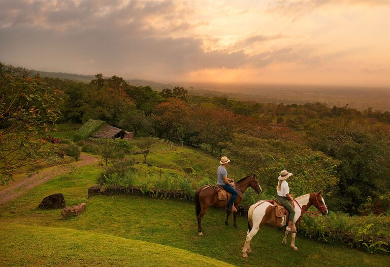 horseback riding couple honeymoon