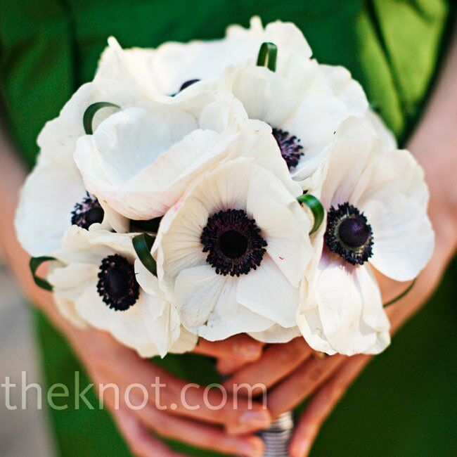 Black-centered anemones tied with black-striped grosgrain ribbon made up the bridesmaid bouquets.