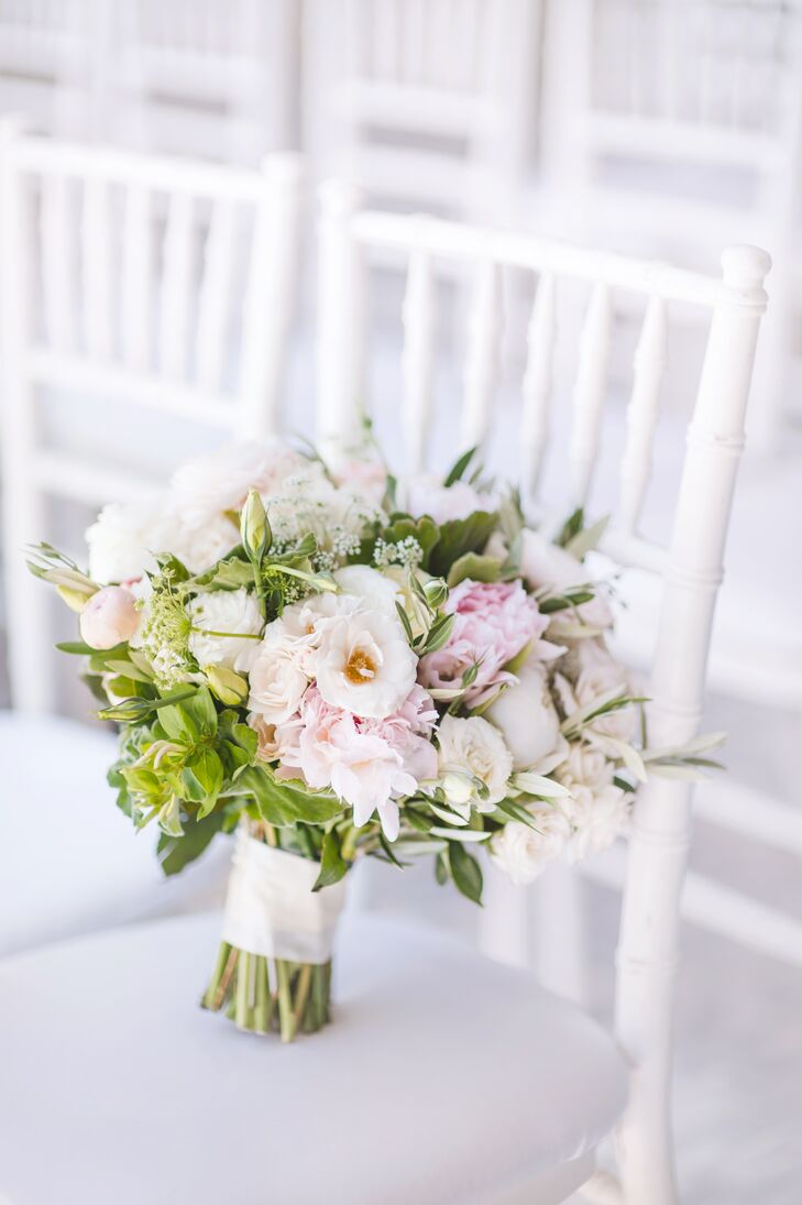 Layers of Lovely crafted a lush blush pink and ivory bouquet with plenty of roses and some greenery.