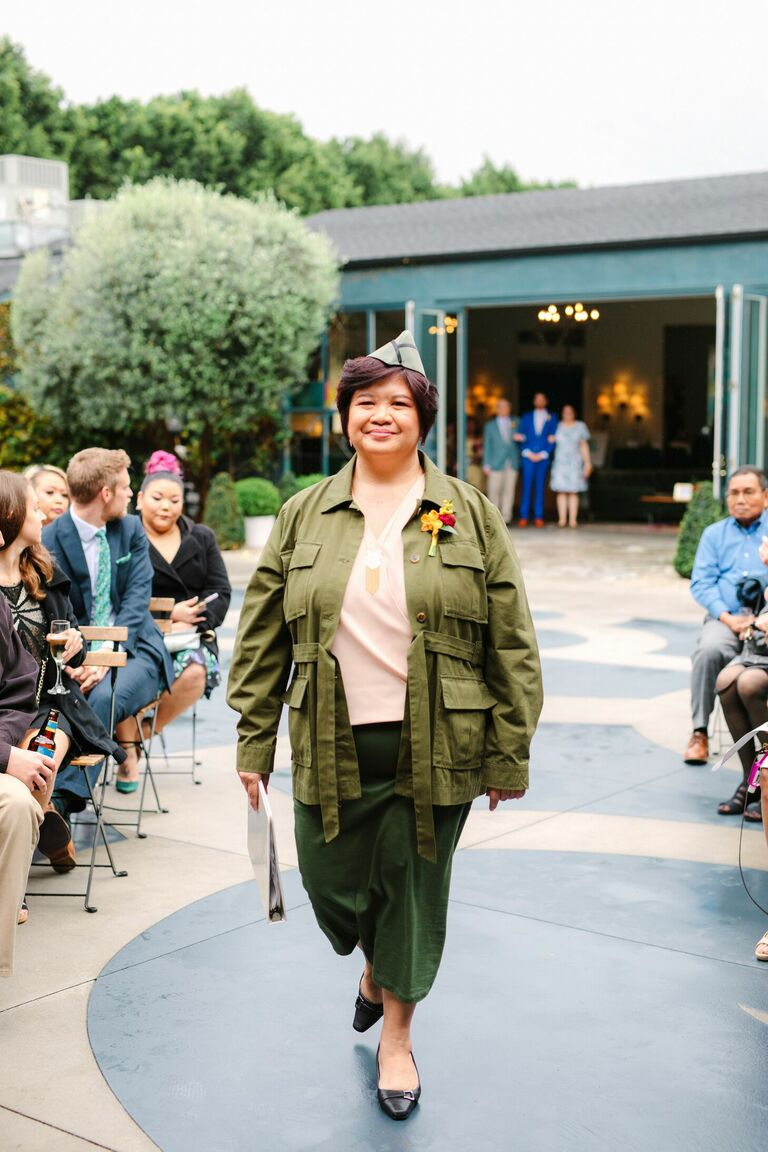 Wedding officiant dressed in green military-inspired attire