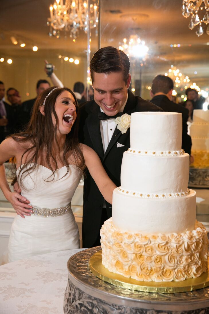 The couple's four-tier white cake's bottom layer was covered in frosted flowers.