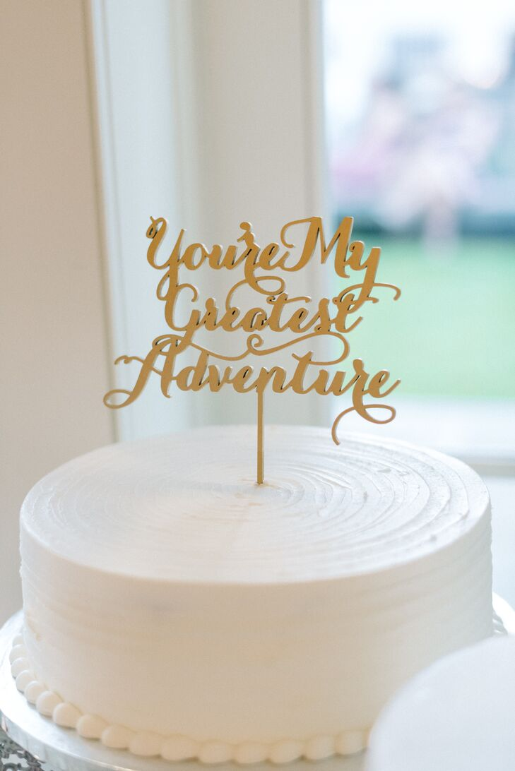 """While their wedding cake had four tiers, Sarah and Steve accented each one with a special quote. The gold topper read """"You're my greatest adventure."""" """"This was a sentiment echoed in our vows,"""" Sarah says. """"Our journey together has been quite an adventure."""""""