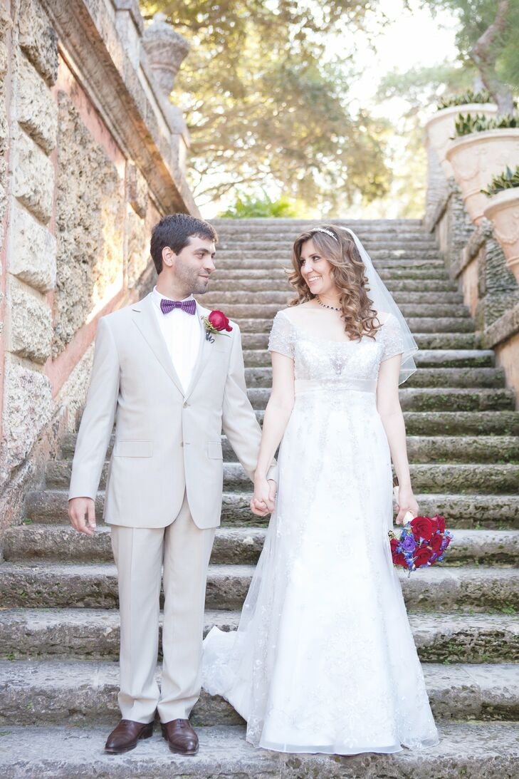 Andrea wore an elegant gown with cap sleeves and beading; Julien matched her style in a pale-gray suit and a purple bow tie.