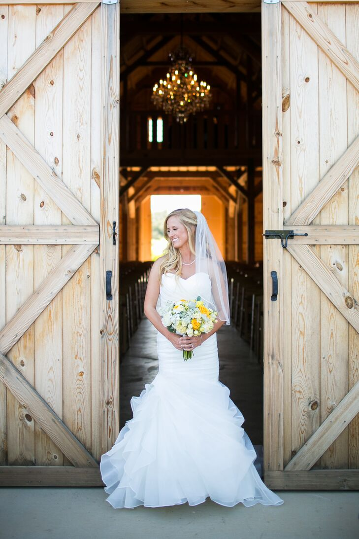 """""""The dress I chose was an ivory Stella York wedding dress with a vintage style that went perfectly with the setting,"""" Lauren says. """"My dress was paired with pearl earrings and a simple pearl necklace given to me by my grandmother."""""""