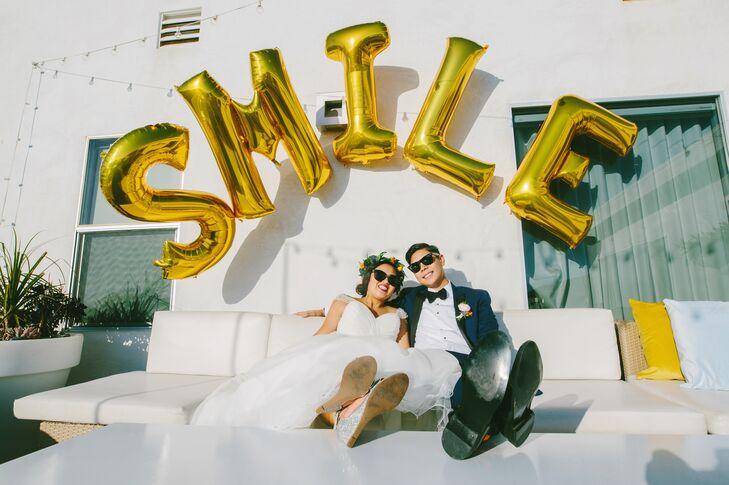 Bride and Groom Beneath Balloon Signage