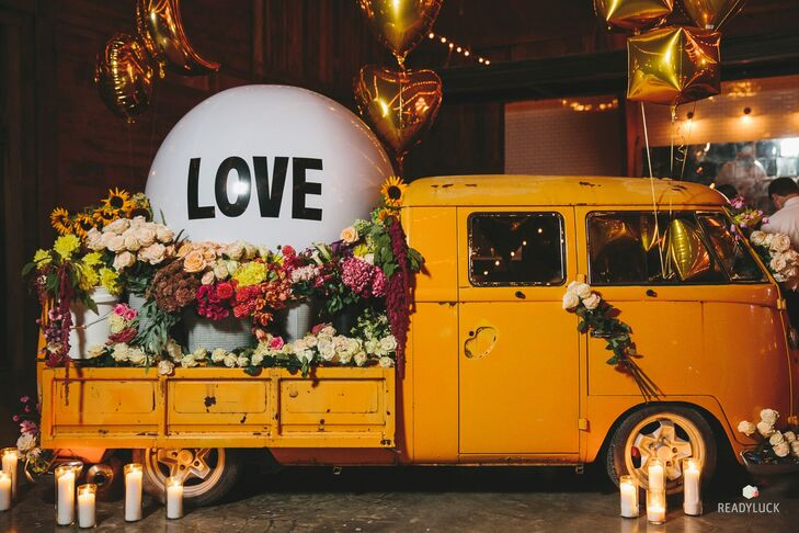 """Amy and Geoff's wedding planners brought in a vintage Volkswagon truck and filled it with flowers, candles and a giant """"Love"""" balloon. """"The space was large, and we had a smaller amount of guests, so it helped keep the atmosphere cozy while creating another great place for photo ops,"""" Amy says."""