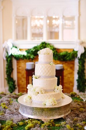 Four-Tier Buttercream Cake with Rhinestone Ribbon and Ivory Ranuncluses