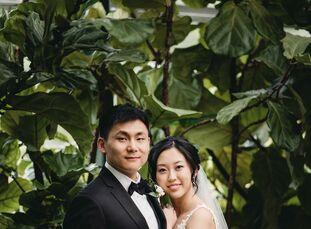 "For their wedding venue, Lulu and Kevin wanted, ""a floral and green space. Planterra Conservatory in Detroit has been voted one of the best wedding ve"
