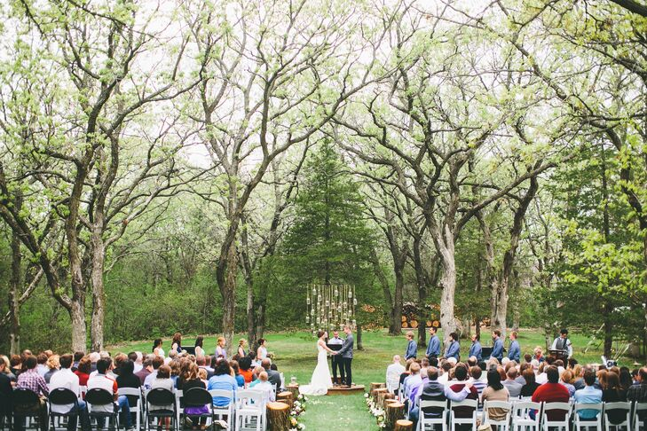The ceremony was nestled within a grove of oak trees. The couple hung mason jars in between two of the trees and used small steps built by the groom and his father as the altar.