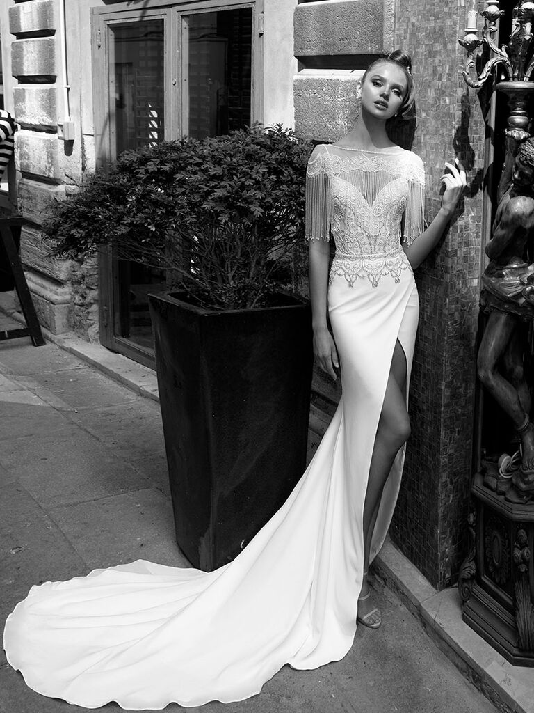 Julie Vino Spring 2018 mermaid wedding dress with sweetheart neckline, front slit skirt and beaded capelet