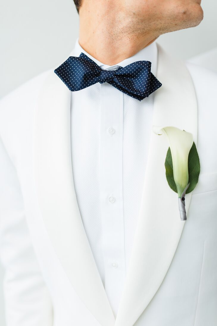 """We wanted all florals to be simple, sleek and somewhat masculine,"" Wes says. ""All flower arrangements and the grooms' boutonnieres were white calla lilies."""