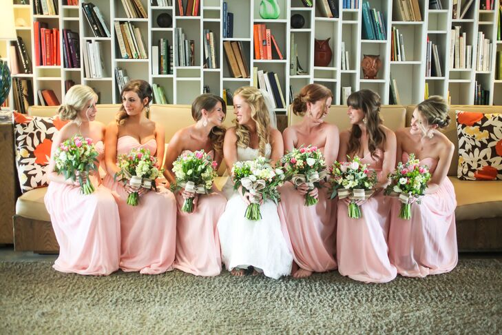 Chelsea's bridesmaids wore  floor-length blush dresses with a sweetheart neckline. During the reception, each woman paired the dress with neutral shoes.