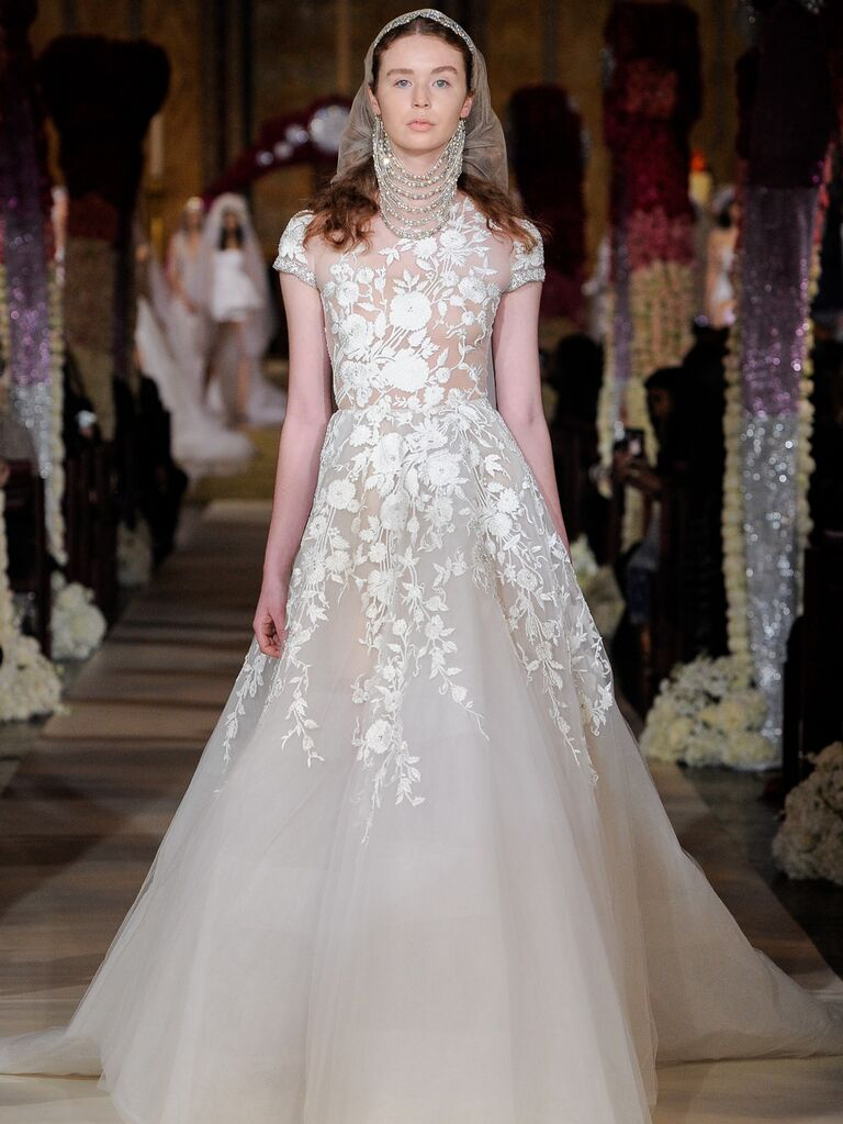 Reem Acra Spring 2020 Bridal Collection lace embroidered wedding dress with illusion bodice and cap sleeves