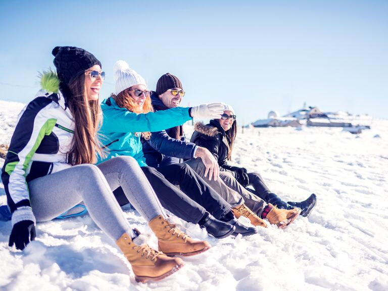 friends in the snow in winter on a mountain