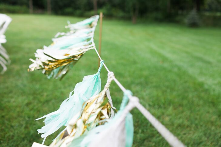 Turquoise and metallic gold tassels added a touch of DIY flair to the couple's outdoor ceremony.