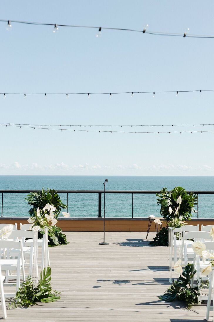 Modern Beach Ceremony Site with Monstera Leaves