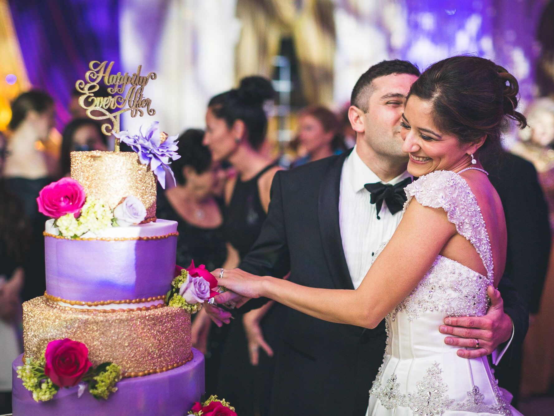 38 of the BEST wedding cake cutting songs for your reception!