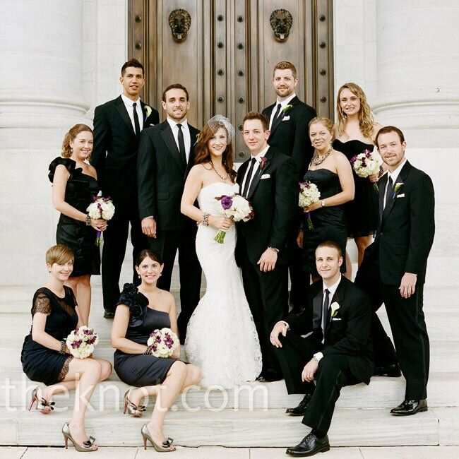 The groomsmen wore tuxes and skinny black ties for a cool, modern look while the bridesmaids chose their own black dresses in sophisticated styles.