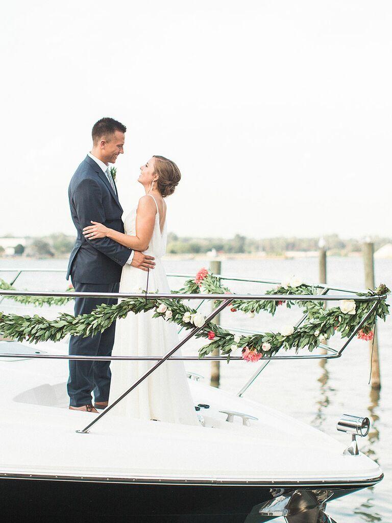 Couple leaving wedding on boat