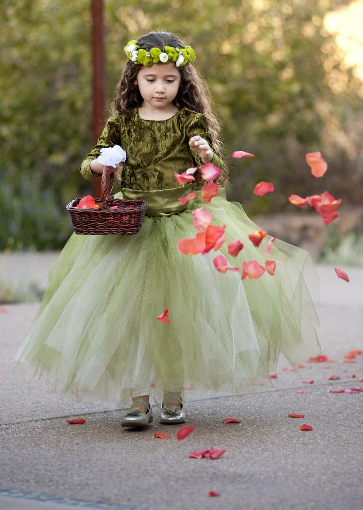 The flower girl walked down the aisle in a full green tulle skirt and crushed top, complemented by a green and white mum floral crown.