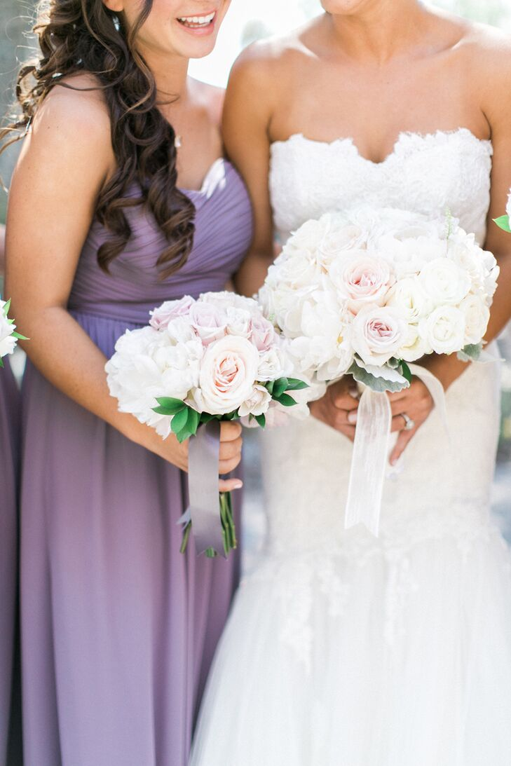 Bree and her bridesmaids carried polished, tightly bundled rose bouquets tied with silk and tulle ribbon.