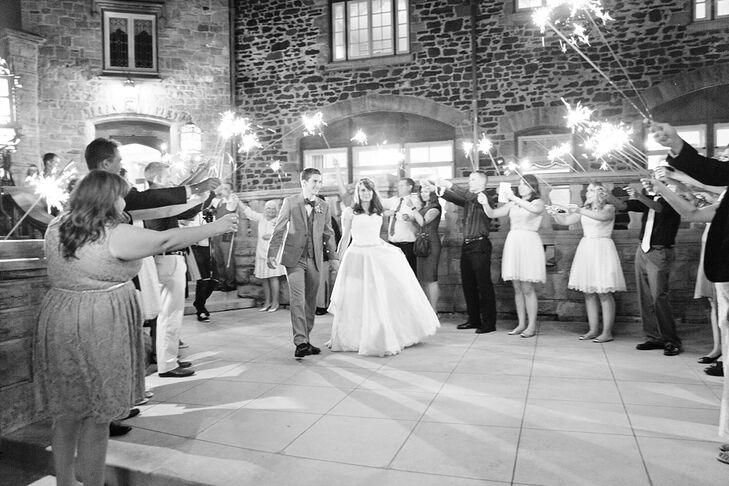 Guests cheered the newly married couple off into the night with a festive sparkler send-off.