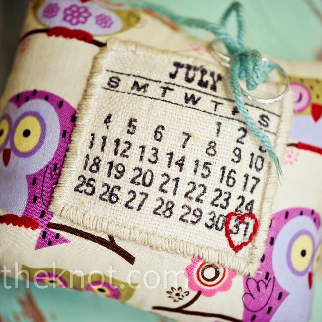 Michael's mom crafted a calendar ring pillow out of owl-printed fabric, with a heart stitched around the couple's wedding date.