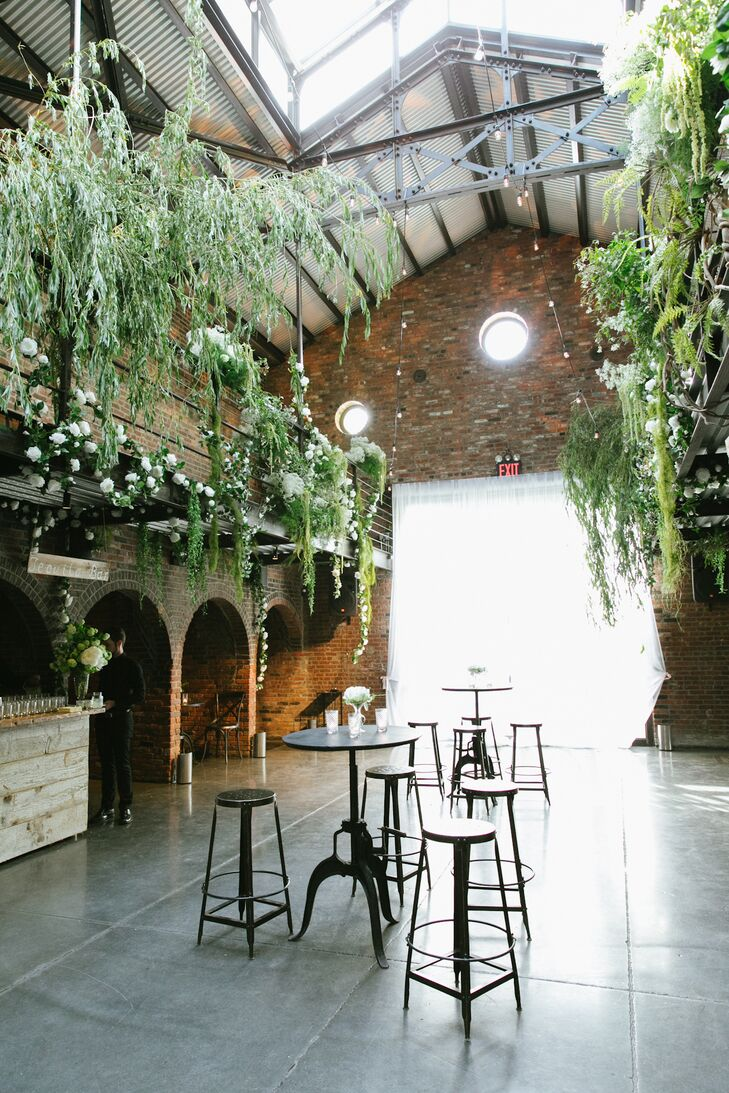 """""""We took one look at it and knew it was the place,"""" Sasha says of The Foundry. """"It was perfect, the combination of a raw space with lots of greenery —it was an architectural gem."""""""
