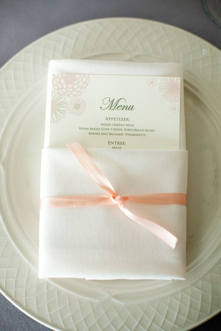 The menus were tucked into simple white linens tired with pale pink ribbon. The menus had the same floral motif as the table numbers and invitations.