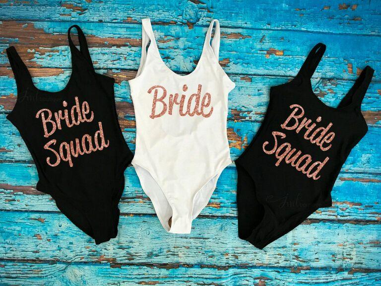 White Bride and black Bride Squad bachelorette bathing suits