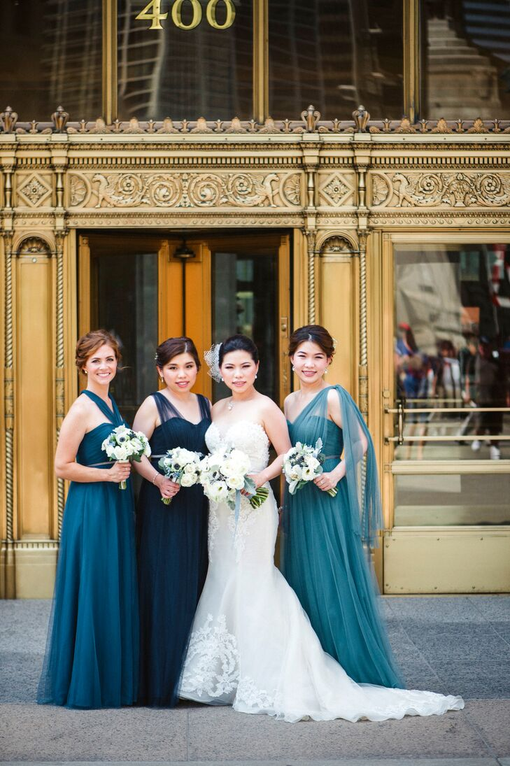 """With two bridesmaids living outside the country, coordinating dress efforts was a little difficult. Lydia bought and shipped her sisters' five dresses in different styles, materials, colors and sizes. They chose a convertible style, Annabelle, by Jenny Yoo. Once she had locked in a dress designer, Lydia picked the three """"loveliest shades of blue"""" and asked her bridesmaids to choose from those shades, then purchased matching belts for all three to unify the look."""