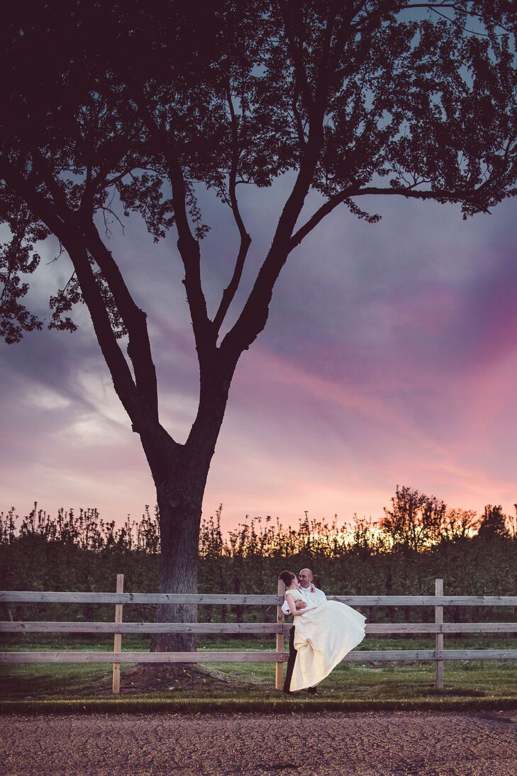 The couple posed for a sunset shot at the County Line Orchard.