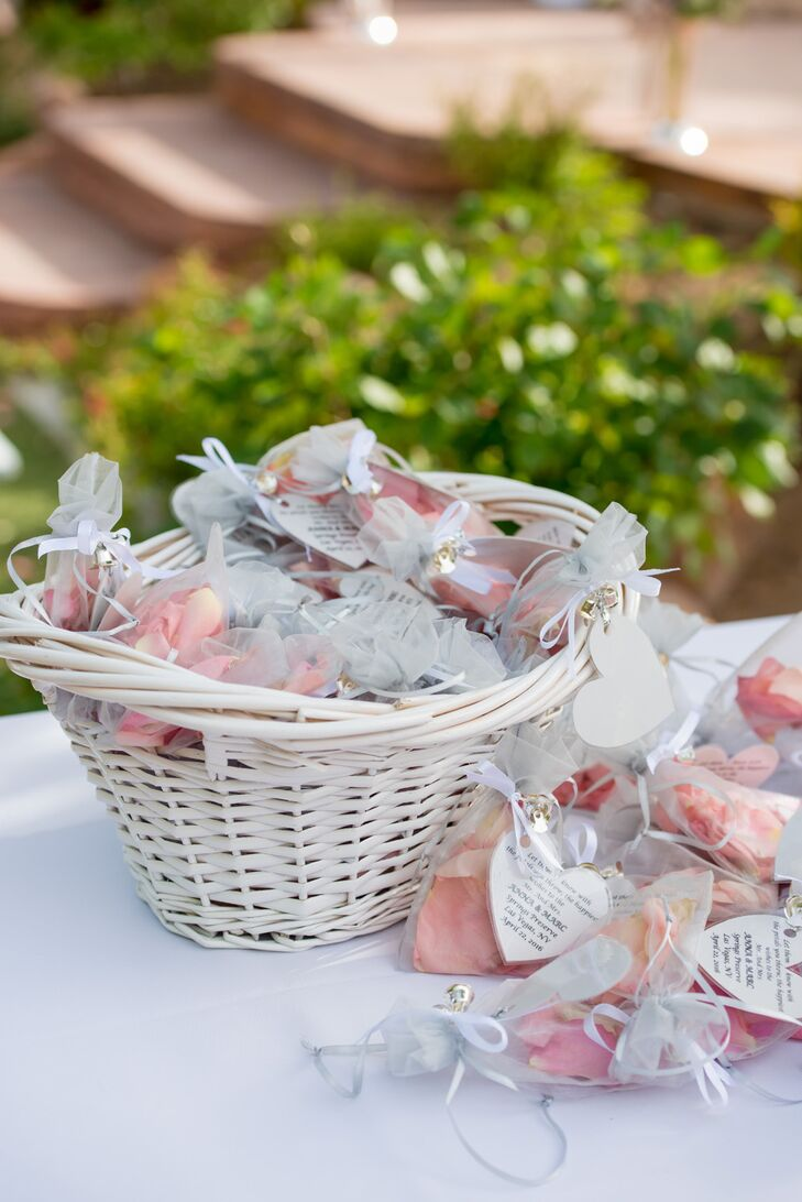 "Bags of rose petals were provided to shower Anna and Marc during the recessional. The newly married couple walked out to the Flaming Lips's ""Do You Realize??"""