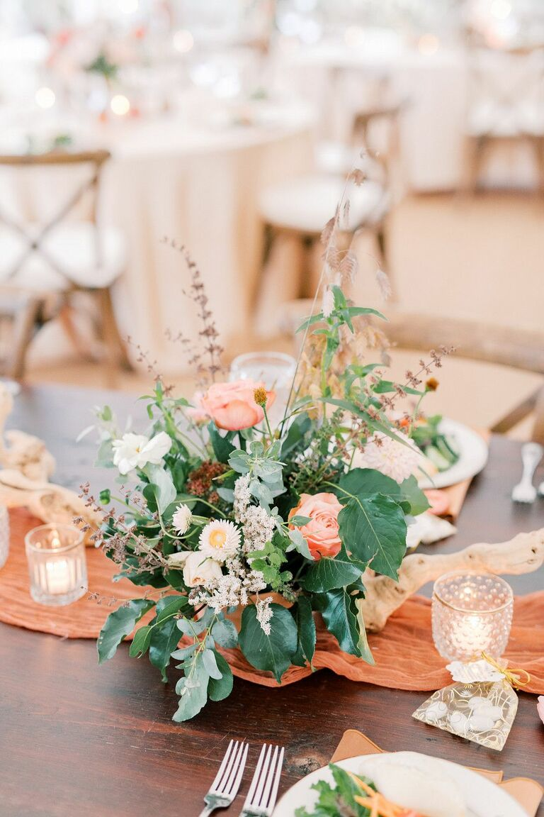 Floral centerpiece with lush greenery