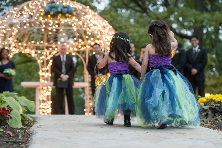 "The five flower girl dresses were handmade by Nicole and Annie Moody, an eBay tutu dressmaker. Rather than the traditional baskets full of flowers, Nicole made her flower girls whimsical ""grapevine balls"" with twinkling fairy lights."