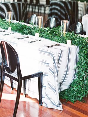 Striped Linens Topped with a Greenery Table Runner and Candles