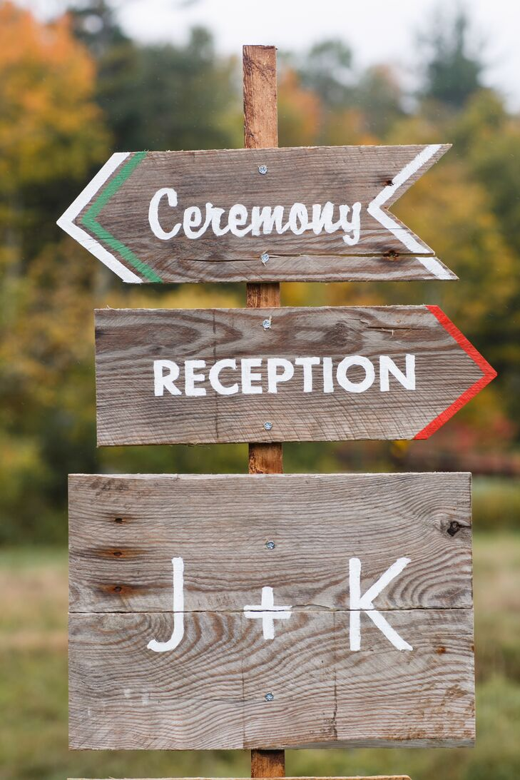 Wooden arrow signs directed guests to the ceremony and reception at the Spruceton Inn in West Kill, New York.