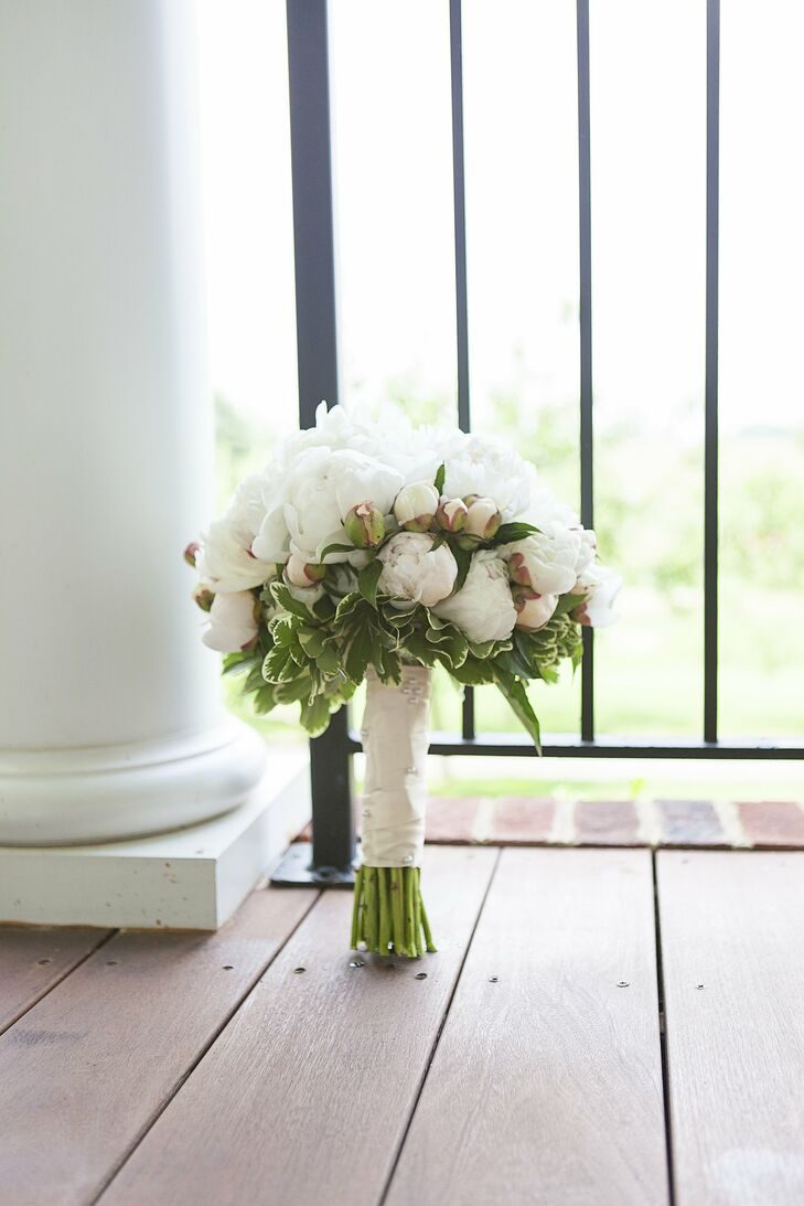 Carter carried a fragrant bouquet of white peonies down the aisle.