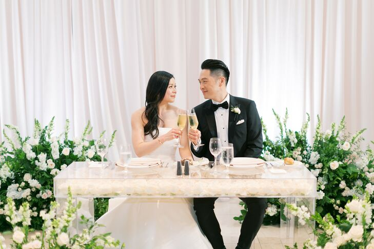 Couple Toasting Champagne at Sweetheart Table