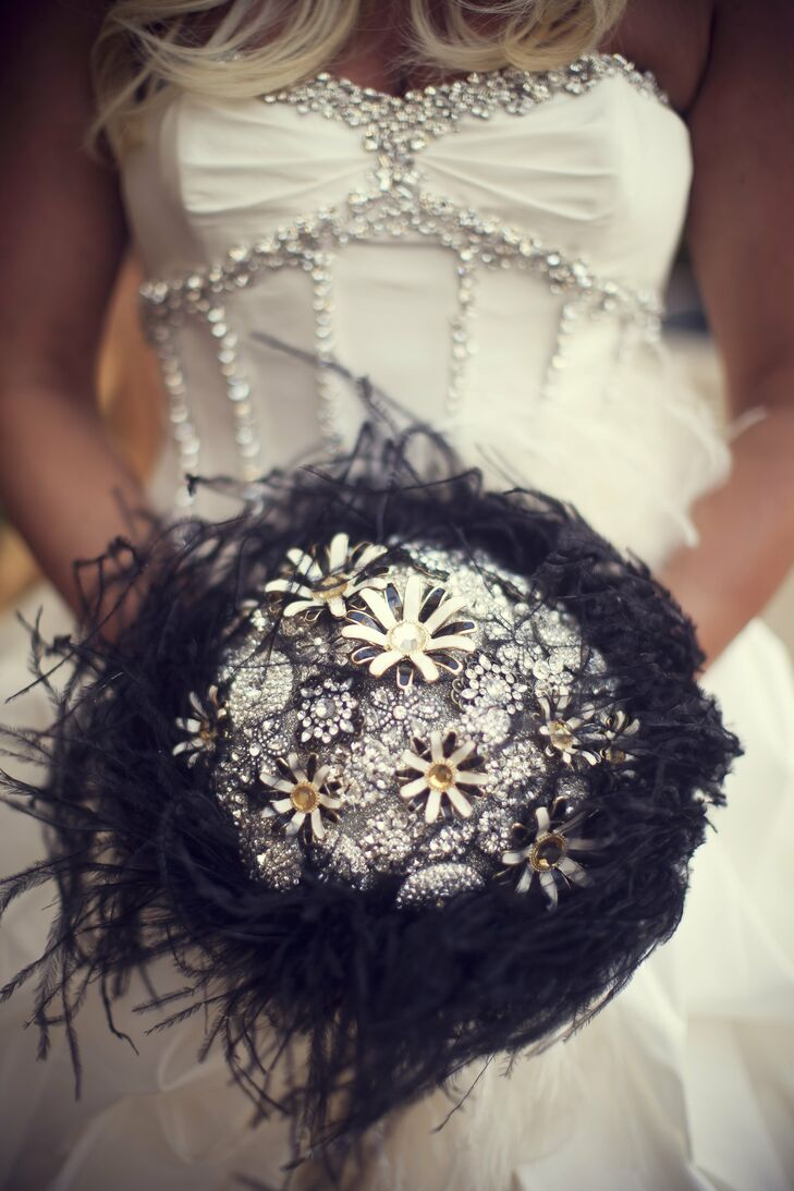 Melissa carried a silver crystal brooch bouquet surrounded by wispy black feathers.