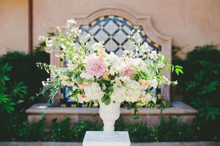 Two textured and romantic arrangements of dahlias, hydrangeas, stock and wildflowers greeted guests as they arrived to the ceremony and set the tone for the chic, romantic decor to come.