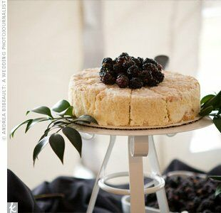 Dennis selected an Italian-style groom's cake topped with blackberries, which was set on leaves to create an earthy look.