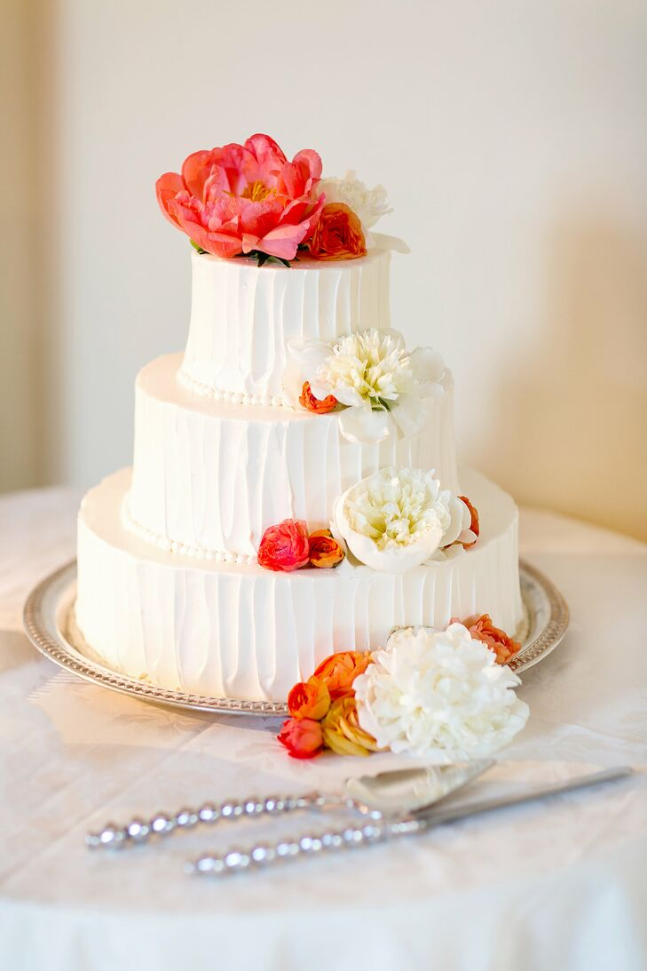 Buttercream Wedding Cake With Coral and White Flowers
