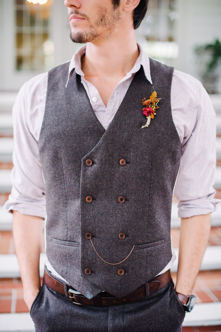 """Zack took on a slightly more formal look than his groomsmen. He was ready for fall in a dapper, tweed double-breasted vest and matching pants by River Island. """"We added a dark brown pocket chain to his vest. It gave us a matching look: his chain and my draping chains on my belt,"""" Shelby says. The addition also resembled a pocket watch chain, giving his look a more vintage vibe."""