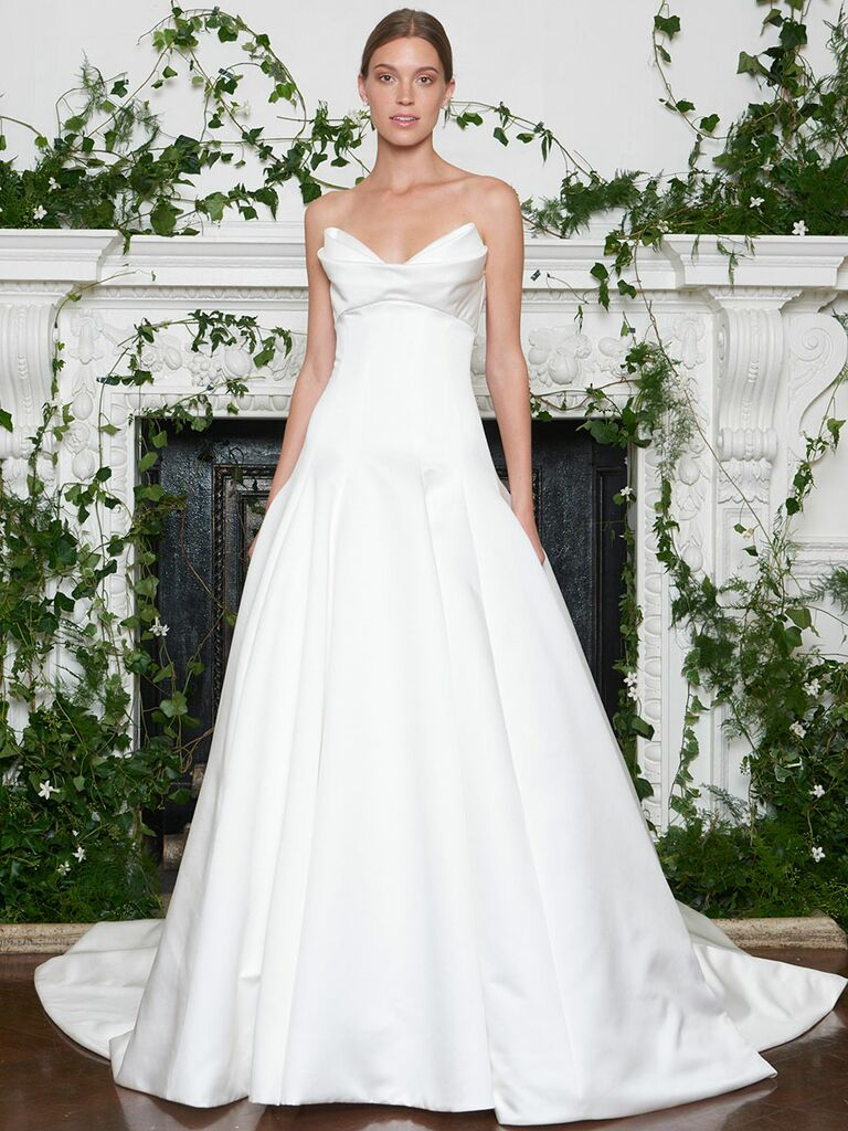 Monique Lhuillier Fall 2018 Duchess satin strapless modified A-line wedding dress with elongated bodice and origami draped neckline