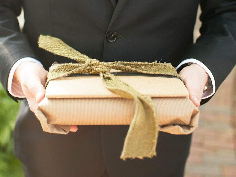 Groom holding gift for wedding day exchange