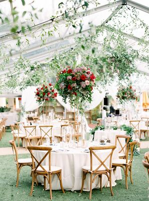 A Tented, Garden-Like Reception with Cross-Back Chairs, Tall Centerpieces and Hanging Greenery